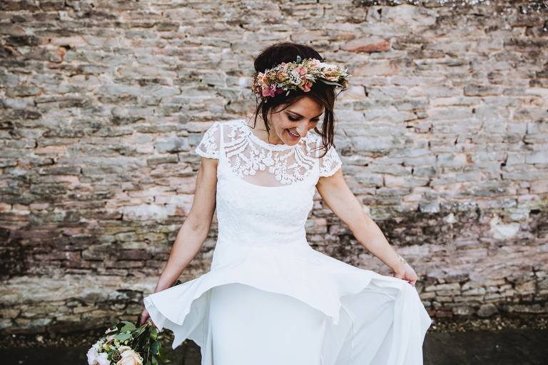 cripps stone barn natural wedding photograph of bride wearing temperley dress and large flower crown
