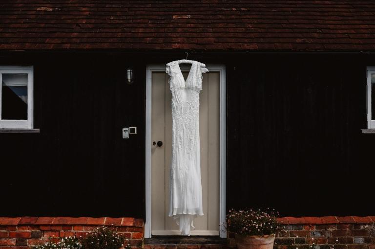 Coverwood Lakes Wedding Photographer Oxfordshire 12 Eliza Jane Howell wedding dress hung up