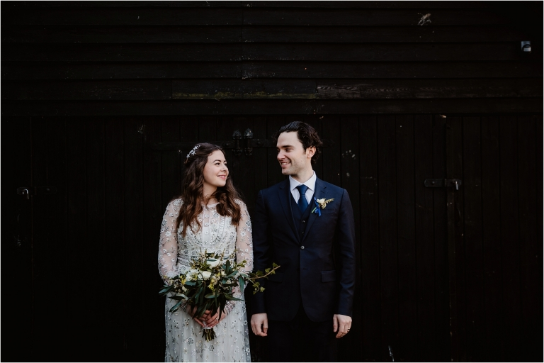 old luxters barn wedding photography bride and groom outside barn