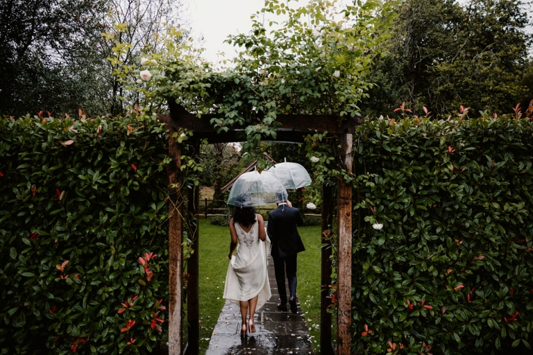 walking out in the gardens at millbridge court wedding